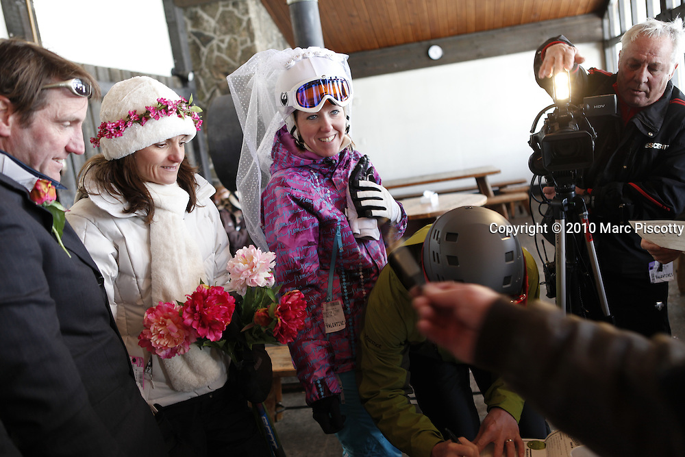 SHOT 2/14/11 1:28:22 PM - Loveland Ski Area in Colorado hosted the 20th Annual Marry Me & Ski Free Mountaintop Matrimony on Valentine's Day Monday, February 14th. The mass wedding ceremony was held at noon at 12,050 feet outside of the Ptarmigan Roost Cabin at Loveland. More than 75 couples were pre-registered to get married or renew their vows high on The Continental Divide in this yearly Loveland tradition.  Following the ceremony couples were invited to a casual reception complete with a champagne toast, wedding cake and music.  (Photo by Marc Piscotty / © 2010)
