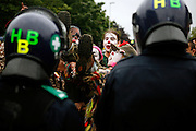 Climate change activists are protesting in front of the British police during a 24 hours mass action being held near the British Airport Association (BAA) headquarters, close to Heathrow airport, to demonstrate against climate change and the expansion plans for the airport on Sunday, Aug. 19, 2007, Heathrow, England. More than 1800 police officers were deployed to counter the activists in their plan to disrupt the BAA activities on the site. Aviation is the fastest growing source of greenhouse gas emissions in the UK, and all our efforts to tackle climate change in other sectors are undone by the massive growth in air travel. Holding the camp at Heathrow aims to highlight the paradoxical government's airport expansion plans, target industry giants profiteering from the climate crisis, and raise awareness about the need to fly less. The camp also support local residents in their long-term struggle against the building of a third runway and the destruction of their communities. Heathrow, the world's busiest international airport, has been the target of Climat Camp campaing in 2007. www.climatecamp.org.uk   **Italy Out**