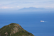 View over the Mediterranenan Sea towards Elba from San-Martino-di-Lota. A Moby ferry on its way to Italy.