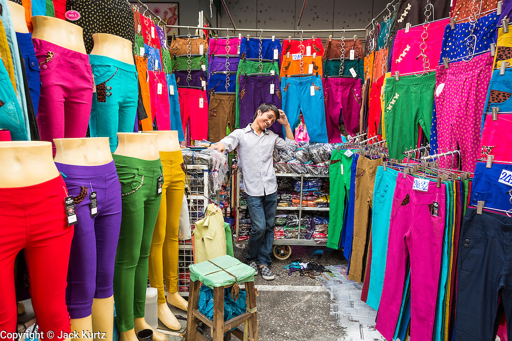 06 JUNE 2013 - BANGKOK, THAILAND:     A wholesale clothing vendor in Bobae Market in Bangkok. Bobae Market is a 30 year old market famous for fashion wholesale and is now very popular with exporters from around the world. Bobae Tower is next to the market and  advertises itself as having 1,300 stalls under one roof and claims to be the largest garment wholesale center in Thailand.       PHOTO BY JACK KURTZ