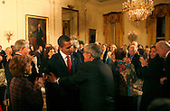 President Barack Obama talks with guests at  a dinner for Congressional  Committee chairmen and ranking members in the East Room of the White House on March 4, 2009.  photo by Dennis Brack
