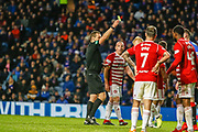 Tom Taiwo of Hamilton Academical FC receives a caution for his foul on Ryan Jack of Rangers during the Ladbrokes Scottish Premiership match between Rangers and Hamilton Academical FC at Ibrox, Glasgow, Scotland on 16 December 2018.
