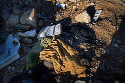 Personal items sit covered by rubble, Aytaroun, Southern Lebanon, Oct. 23, 2006.