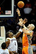 Jan. 19, 2011; Cleveland, OH, USA; Phoenix Suns center Marcin Gortat (4) shoots over Cleveland Cavaliers power forward Antawn Jamison (4) during the third quarter at Quicken Loans Arena. The Suns beat the Cavaliers 106-98. Mandatory Credit: Jason Miller-US PRESSWIRE
