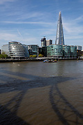 A view across the Thames of the shadow of Tower Bridge looking at  City Hall (left) on the More London development and the Shard London Bridge skyscraper (right),  Central London, UK.  5th May 2016 (photo by Andrew Aitchison / In pictures via Getty Images)