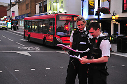 © Licensed to London News Pictures. 15/07/2017<br /> Police attend after a youth was stabbed opposite a McDonalds in Eltham High Street, Eltham, South East London.<br /> Photo credit: Grant Falvey/LNP