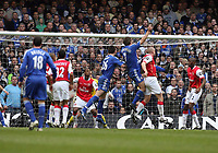 Photo: Rich Eaton.<br /> <br /> Chelsea v Arsenal. Carling Cup Final. 25/02/2007. John Terry of Chelsea #26 jumps for a corner, is injured and then leaves the field on a stretcher in the second half