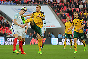 John Stones of England clearing the ball from Deivydas Matulevicius of Lithuania during the FIFA World Cup Qualifier group stage match between England and Lithuania at Wembley Stadium, London, England on 26 March 2017. Photo by Matthew Redman.