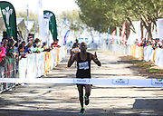 MOSSEL BAY, SOUTH AFRICA - SEPTEMBER 23: Jari Munyarodzi wins the PetroSA Marathon hosted by Athletics South Western Districts (SWD) on September 23, 2017 in Mossel Bay, South Africa. (Photo by Roger Sedres/ImageSA)