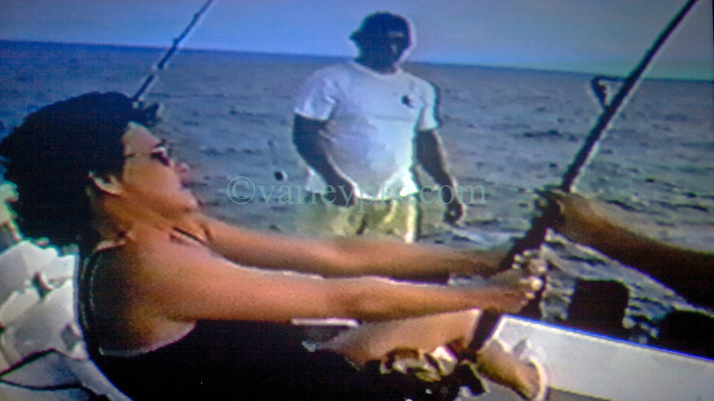 17th November, 2005. Mandeville, Louisiana. <br /> Videograb courtesy denise Leblanc. Off the Panamanian coast, 2000. Denise sits strapped to a chair as she fights to bring in a massive Blue Marlie. Captain 'Kid,' the boat captain who later helped to save her life stands behind her. On a later trip, a marlins' sharp sword like nose punctured Denise's chest, through her breast implant and out of her back as she shot the video. Denise barely survived the horrific attack off the Panamanian coast where she was sport fishing. Denise and her doctors have credited her breast implant with saving her life. <br /> Photo; Charlie Varley<br /> varleypix.com<br /> Video grab courtesy; Denise Le Blanc
