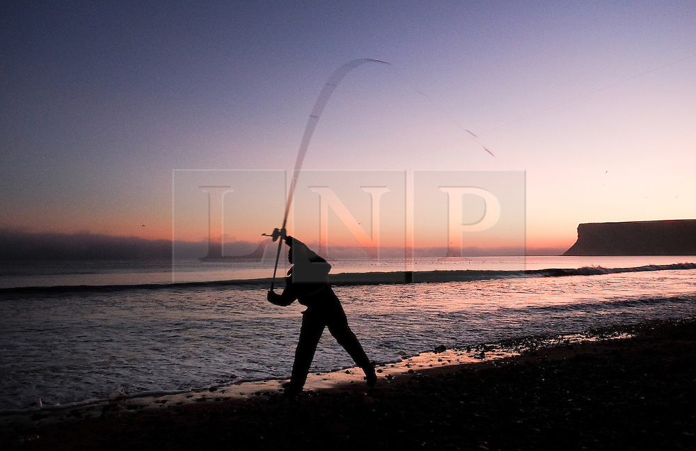 © Licensed to London News Pictures.02/11/15<br /> Saltburn, UK. <br /> <br /> A fisherman casts out as a heavy fog bank sits out at sea from the Cleveland coast.<br /> <br /> Photo credit : Ian Forsyth/LNP