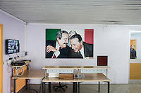 LECCE, ITALY - 10 NOVEMBER 2016: A painting of (L-R) Giovanni Falcone and Paolo Borsellino, two anti-Mafia magistrates assassinated by the Mafia in 1992, is seen here at the entrance of the male inmates unit of the largest penitentiary in the southern Italian region of Apulia, holding 1,004 inmates in the outskirts of Lecce, Italy, on November 10th 2016.<br /> <br /> Here a group of ten high-security female inmates and aspiring sommeliers , some of which are married to mafia mobsters or have been convicted for criminal association (crimes carrying up to to decades of jail time), are taking a course of eight lessons to learn how to taste, choose and serve local wines.<br /> <br /> The classes are part of a wide-ranging educational program to teach inmates new professional skills, as well as help them develop a bond with the region they live in.<br /> <br /> Since the 1970s, Italian norms have been providing for reeducation and a personalized approach to detention. However, the lack of funds to rehabilitate inmates, alongside the chronic overcrowding of Italian prisons, have created a reality of thousands of incarcerated men and women with little to do all day long. Especially those with a serious criminal record, experts said, need dedicated therapy and professionals who can help them.
