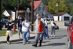 Lisa Williams, center with the Rowan County Rights Coalition helps Taral Thompson, left, remove an effigy of Rowan County Clerk Kim Davis near the courthouse, Saturday, Aug. 29, 2015 in Morehead.