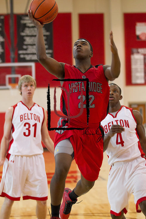 Vista Ridge's Stedman Mayberry attempts a shot against Belton during the Leander ISD Tournament held at Vista Ridge.  The Rangers beat Belton 63-46 Friday.