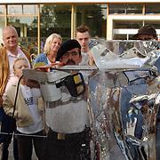 IJs beeldhouwerken ateliersroute 2001 Huizen, demonstratie kettingzaag