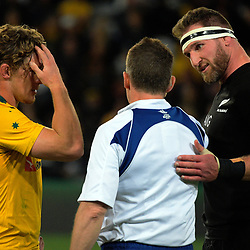 Captains Michael Hooper (left) andf Kieran Read talk to referee Nigel Owens during the Rugby Championship and Bledisloe Cup rugby match between the New Zealand All Blacks and Australia Wallabies at Forsyth Barr Stadium in Dunedin, New Zealand on Saturday, 26 August 2017. Photo: Dave Lintott / lintottphoto.co.nz