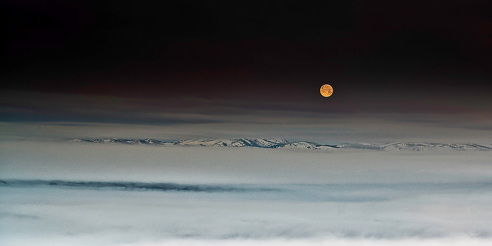 A wintery moonset over the Caribou Range just beyond Wyoming's Star Valley.