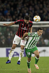 November 8, 2018 - Seville, Spain - MATEO MUSSACCHIO of Milan (L) fights for the ball with ANDRES GUARDADO of Betis (R) during the Europa League Group F soccer match between Real Betis and AC Milan at the Benito Villamarin Stadium (Credit Image: © Daniel Gonzalez Acuna/ZUMA Wire)