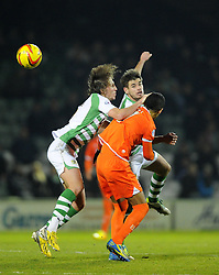 Yeovil Town's Luke Ayling and Yeovil Town's Joe Edwards battles for the high ball with Blackpool's Thomas Ince - Photo mandatory by-line: Joe Meredith/JMP - Tel: Mobile: 07966 386802 03/12/2013 - SPORT - Football - Yeovil - Huish Park - Yeovil Town v Blackpool - Sky Bet Championship