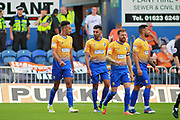 Mansfield Town defender Rhys Bennett (2) celebrates the first goal during the EFL Sky Bet League 2 match between Mansfield Town and Luton Town at the One Call Stadium, Mansfield, England on 26 August 2017. Photo by Nigel Cole.