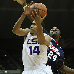 14 February 2009 LSU guard Garrett Temple (14) shoots over Terrico White (24) of Ole Miss during a NCAA basketball game between SEC rivals the Ole Miss Rebels and the LSU Tigers at the Pete Maravich Assembly Center in Baton Rouge, LA.