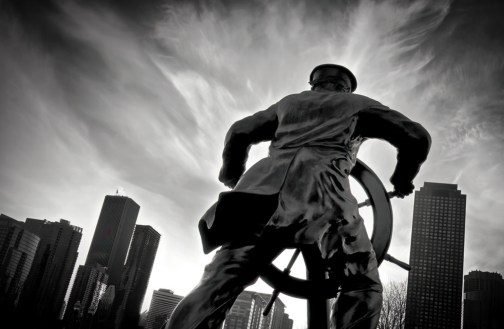 "Sailing into a Storm... this is a silhouette of the dramatic statue entitled ""Captain on the Helm"" by sculptor Michael Martino located on the waterfront just south of Navy Pier in Chicago, Illinois on one hell of a stormy day."