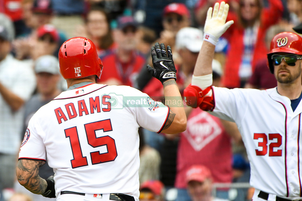 May 6, 2018 - Washington, DC, U.S. - WASHINGTON, DC - MAY 06:  Washington Nationals first baseman Matt Adams (15) is congratulated by catcher Matt Wieters (32) after hitting a solo home run in the second inning during the game between the Philadelphia Phillies and the Washington Nationals on May 6, 2018, at Nationals Park, in Washington D.C.  The Washington Nationals defeated the Philadelphia Phillies, 5-4.  (Photo by Mark Goldman/Icon Sportswire) (Credit Image: © Mark Goldman/Icon SMI via ZUMA Press)