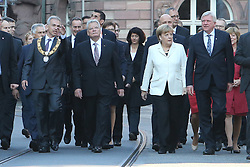 03.10.2015, Frankfurt am Main, GER, Tag der Deutschen Einheit, im Bild Gang von der Paulskirche zum Frankfurter Dom, von links: Oberbuergermeister Peter Feldmann erklaert neben Bundespraesident Joachim Gauch, Bundeskanzlerin Angela Merkel, Bundesratspraesident und Ministerpraesident Volker Bouffier // during the celebrations of the 25 th anniversary of German Unity Day in Frankfurt am Main, Germany on 2015/10/03. EXPA Pictures © 2015, PhotoCredit: EXPA/ Eibner-Pressefoto/ Roskaritz<br /> <br /> *****ATTENTION - OUT of GER*****