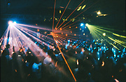 Ravers under strobe lights in a nightclub, London, UK
