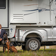 CORAL SPRINGS, FLORIDA -- JANUARY  28, 2019: Andrew Pollack,  whose 18 year old daughter Meadow Pollack was one of the victims of the masacre in Marjorie Stoneman Douglas High School in Parkland, Florida in February of 2018,  with his Belgium malinois Sunny in front of an RV he's been calling home recently. The vehicle is currently parked on the grounds of a Coral Springs temple. <br /> (Angel Valentin / For The Times)