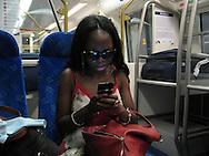 South Africa, Johannesburg, 2012. Nonkosana Nydayi on her way to OR Tambo International Airport via the Gautrain.