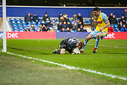 Queens Park Rangers goalkeeper Joe Lumley (13) keeps hold of the ball as Rotherham United defender Richard Wood (6) approaches during the EFL Sky Bet Championship match between Queens Park Rangers and Rotherham United at the Loftus Road Stadium, London, England on 13 March 2019.