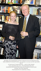 MR MIKE HOLLINGSWORTH former husband of Anne Diamond and MISS KIMBERLEY STEWART-MOLE, at a party in London on 8th April 2003.PIS 37