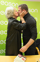 Repro Free: 13/11/2014 Dermot O&rsquo;Leary gets a big suprise kiss from Annette Kane from Donnybrook Co Dublin at the signing of his new book, &lsquo;The Soundtrack to My Life&rsquo;, today in Eason O&rsquo;Connell Street. O&rsquo;Leary&rsquo;s book, The Soundtrack to My Life, is currently on sale in Eason stores nationwide and online at www.easons.com retailing at &euro;18.99. Picture Andres Poveda<br />  <br /> For further information, please contact: <br /> Shane Lennon @ Wilson Hartnell<br /> 087 900 0320 / 01 669 0030