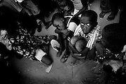 Kid waiting for food in Bissau, street scene