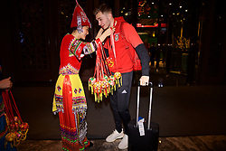 NANNING, CHINA - Monday, March 19, 2018: Wales' xxxx is greeted by a women in traditional costume as the team arrive at the Wanda Realm Resort in Nanning for the 2018 Gree China Cup International Football Championship. (Pic by David Rawcliffe/Propaganda)