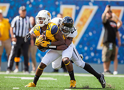 Sep 3, 2016; Morgantown, WV, USA; Missouri Tigers defensive back Anthony Sherrils (22) tackles West Virginia Mountaineers wide receiver Gary Jennings (12) after catching a punt during the first quarter at Milan Puskar Stadium. Mandatory Credit: Ben Queen-USA TODAY Sports