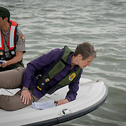 FLORIDA CITY, FLORIDA - APRIL 22, 2016<br /> Sally Jewell, United States Secretary of the interior, along with Pedro Ramos, superintendent of Everglades and Dry Tortugas National Parks in Florida, looks at grass that was floating in the waters of the Everglades National Park  during a trip to look at dying sea grass.<br /> (Photo by Angel Valentin)