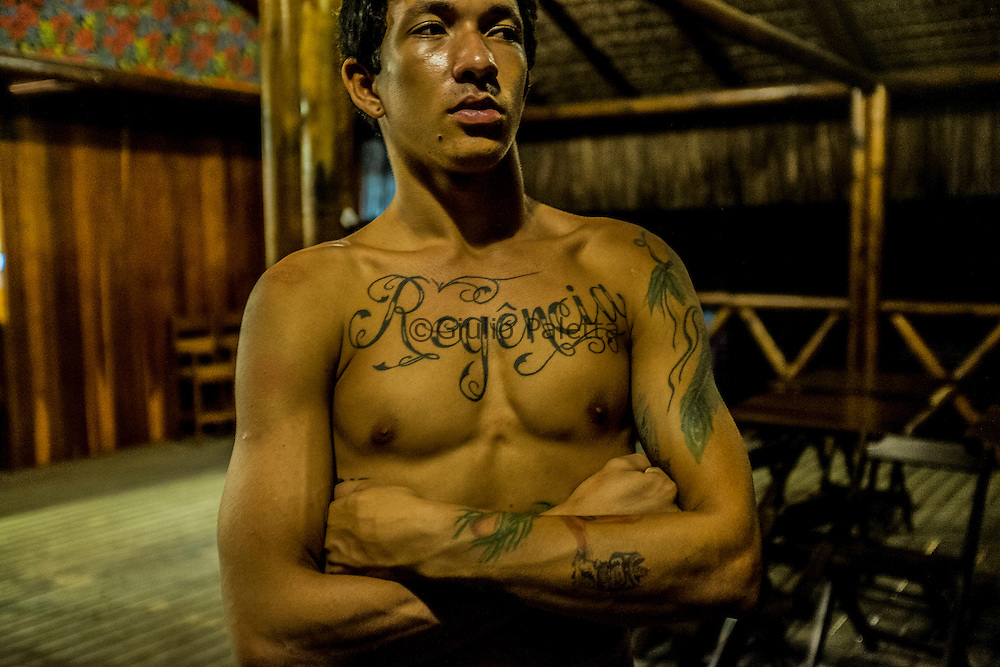 A young surfer from Regencia proudly shows his tattoo