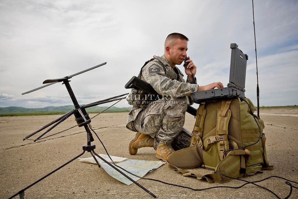 Computing and technology use by military personnel in tactical setting.  Computer is either Getac or Dell.  Photo complies with US Department of Defense regulations for use in advertising.