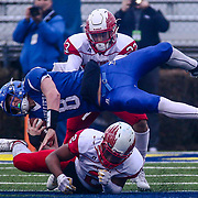 Middletown quarterback Drew Fry (8) is up-ended by Smyrna's JEREMY D'AGUIAR (23) in the fourth quarter of the 2017  DIAA Division I state championship game between the Smyrna Eagles and Middletown Cavaliers Saturday, Dec. 02, 2017 at Delaware Stadium in Newark, DE.