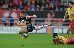 Bristol Rugby Scrum-Half Will Cliff is challenged by Scarlets Outside Centre Jacob Cowley - Mandatory byline: Dougie Allward/JMP - 07966 386802 - 22/11/2015 - RUGBY - Ashton Gate - Bristol, England - Bristol Rugby v Scarlets Select - British & Irish Cup