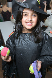 Primary school girl in fancy dress at Bring and Buy sale,