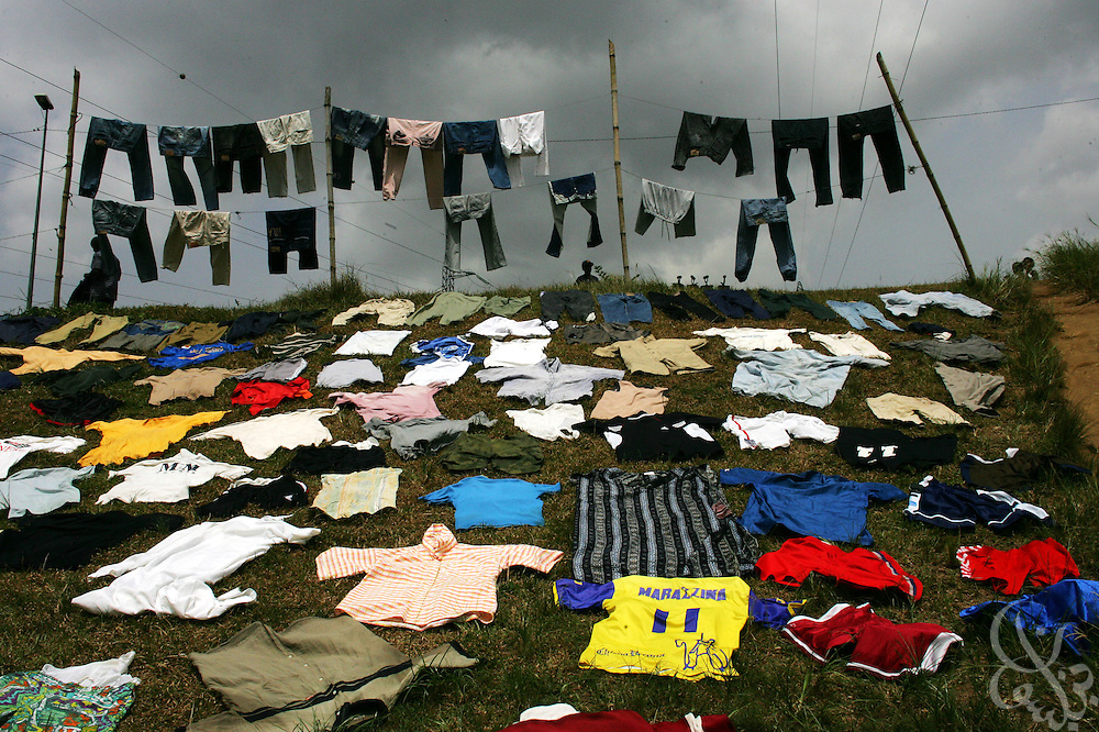 A highway overpass provides a place for laundry(including numerous football jerseys) to be layed out to dry in the Yopoungon  neighborhood of Abidjan, Côte d'Ivoire February 19,2006.   Football is an integral part of the social fabric of the Côte d'Ivoire.