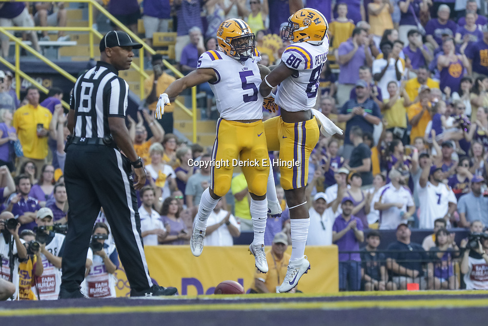 Sep 23, 2017; Baton Rouge, LA, USA; LSU Tigers running back Derrius Guice (5) celebrates a touchdown with tight end Jamal Pettigrew (80) during the first quarter of a game against the Syracuse Orange at Tiger Stadium. Mandatory Credit: Derick E. Hingle-USA TODAY Sports