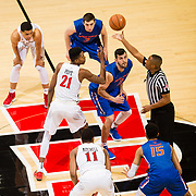 27 February 2018: San Diego State men's basketball hosts Boise State in it's last meet up of the regular season at Viejas Arena. San Diego State Aztecs forward Malik Pope (21) takes the tip off against Boise State Broncos forward Zach Haney (11) to start the game. The Aztecs lead 38-37 at halftime. <br /> More game action at sdsuaztecphotos.com