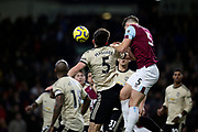 Burnley defender James Tarkowski 5) outjumps Manchester United defender Harry Maguire (5) to get to the high ball during the Premier League match between Burnley and Manchester United at Turf Moor, Burnley, England on 28 December 2019.