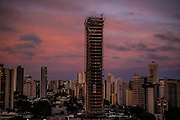 An unfinished luxury tower stands idle at a wealthy neighbourhood of Goiania,  Brazil, Saturday, Dec. 17, 2016.  Considered one of the economic pillars of Brazil, hoarding increasingly huge swaths of land and spreading the same amounts of environmental degradation and land conflicts, the powerful agribusiness finds its heart, soul and voice in the city of Goiânia. Home of a million and a half souls it sits on the immense central plains of Brazil and nurtures a rodeo culture and cowboy lifestyle challenging its own urbanization, highlighting the archaic and rural character of Brazilian mindset and its society. (Dado Galdieri for the New York Times)