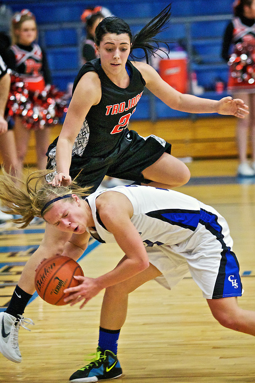 Coeur d'Alene High's Madison Sumner takes a hard foul from Lexi Smith from Post Falls High during a fast break in the first half of the Viking's 50-22 win over the Trojans in the 5A Region 1 championship game Tuesday.