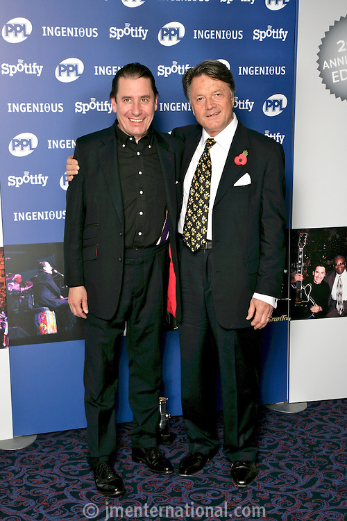Jools Holland and Fran Nevrkla, the 2011 MITs Award. Held at the Grosvenor Hotel London in aid of Nordoff Robbins and the BRIT School. Monday, Nov.7, 2011